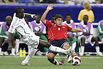 15 July 2007: Chile's Dagoberto Currimilla (8) tackles the ball away from Nigeria's Suraj Sodiq. Chile's Under-20 Men's National Team defeated Nigeria's Under-20 Men's National Team 4-0 after extra time in a  quarterfinal match at Olympic Stadium in Montreal, Quebec, Canada during the FIFA U-20 World Cup Canada 2007 tournament.