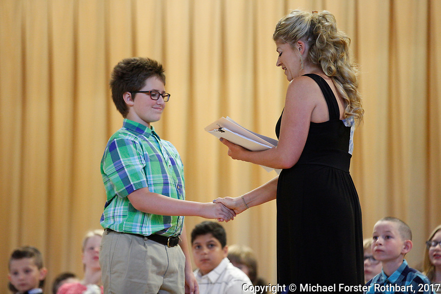 The Oneonta Greater Plains elementary school fifth grade awards ceremony, on June 21, 2017.<br /> &copy; Michael Forster Rothbart Photography<br /> www.mfrphoto.org &bull; 607-267-4893<br /> 34 Spruce St, Oneonta, NY 13820<br /> 86 Three Mile Pond Rd, Vassalboro, ME 04989<br /> info@mfrphoto.org<br /> Photo by: Michael Forster Rothbart<br /> Date:  6/21/2017<br /> File#:  Canon &mdash; Canon EOS 5D Mark III digital camera frame C19149