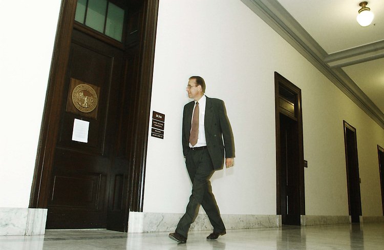 10/08/04.DAYTON CLOSES OFFICE IN RUSSELL BUILDING--A man who declined to be identified walks by the office of Sen. Mark Dayton, D-Minn., who closed his Russell Building office on Tuesday, saying information in a classified intelligence report had convinced him to keep his staff away from Capitol Hill until after the Nov. 2 election. A statement by Dayton regarding the closure is taped to the door..CONGRESSIONAL QUARTERLY PHOTO BY SCOTT J. FERRELL