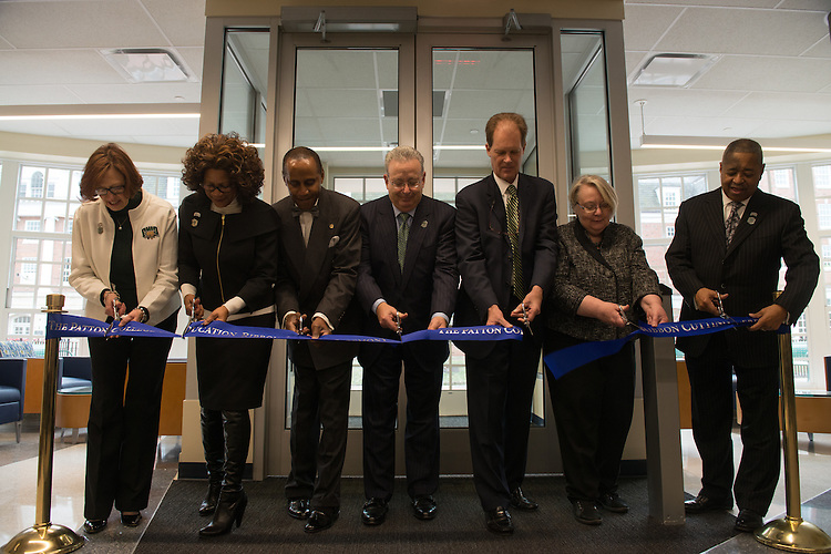From right: President Roderick McDavis, Executive Vice President Pam Benoit, Vice President for Development Bryan Benchoff, Chair of the Board of Trustees David A. Wolfort, Emeriti Faculty Glenn Doston, Dean Renee Middleton and Linda Reed perform the ribbon cutting for the Gladys W. and David H. Patton College of Education's newly renovated McCracken Hall held on January 27, 2017.