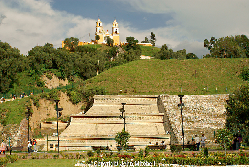 Reconstructed western base of Tapaneca Pyramid and Santuario de Nuestra Senora de los Remedios church in Cholula, Puebla, Mexico. Cholula is a UNESCO World Heritage Site.