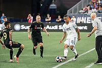 FOXBOROUGH, MA - AUGUST 3: Brandon Bye #15 of New England Revolution passes the ball along the sideline during a game between Los Angeles FC and New England Revolution at Gillette Stadium on August 3, 2019 in Foxborough, Massachusetts.
