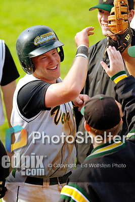 18 May 2006: Kyle Massie,  a University of Vermont Sophomore from Rutland, VT, gets high-fives from teammates after scoring against the University of Maine Black Bears, at Historic Centennial Field, in Burlington, Vermont...Mandatory Photo Credit: Ed Wolfstein Photo.