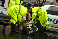 December 7, 2011  (Washington, DC)  A woman is arrested after defying police orders during an OccupyDC protest. An estimated four dozen or more were arrested after protesters blocked K Street in downtown Washington.   (Photo by Don Baxter/Media Images International)