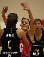 World 7 captain Natasha Chokljat tries to block Temepara George during the International  Netball Series match between the NZ Silver Ferns and World 7 at TSB Bank Arena, Wellington, New Zealand on Monday, 24 August 2009. Photo: Dave Lintott / lintottphoto.co.nz