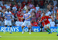 FAO SPORTS PICTURE DESK<br /> Pictured: Adel Taarabt of QPR (C) controls the bal with his head, marked by Leon Britton of Swansea (R). Saturday 18 August 2012<br /> Re: Barclay's Premier League, Queens Park Rangers v Swansea City FC at Loftus Road Stadium, London, UK.
