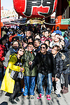Asian tourists take a selfie at the entrance of Sensoji temple in Asakusa district on January 22, 2016, Tokyo, Japan. The Japan National Tourism Organization reported on Tuesday 19th a record increase in foreign visitors in 2015. Approximately 19.73 million people visited Japan from abroad, up 47.3 percent. According to the report there were more Chinese visitors than from any other nation with 4.99 million coming in 2015. South Korea (4 million) and Taiwan (3.67 million) were next on the list, and over 1 million Americans also visited Japan in 2015. The number of visitors is the highest in 45 years and already close to Japan's goal of attracting 20 million foreign visitors in a year by 2020. (Photo by Rodrigo Reyes Marin/AFLO)