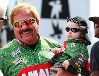 Apr 27, 2014; Baytown, TX, USA; NHRA top fuel dragster driver Terry McMillen  with son Cameron McMillen during the Spring Nationals at Royal Purple Raceway. Mandatory Credit: Mark J. Rebilas-