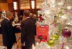 Guests browse near one of the festive trees at the Trees of Hope Gala benefitting Star of Hope children's programs at the HIlton Americas Hotel Friday Nov. 20,2009. (Dave Rossman/For the Chronicle)