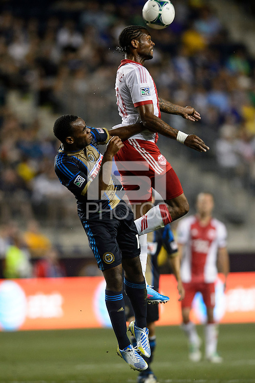 Frederic Piquionne (10) of the Portland Timbers goes up for a header with Amobi Okugo (14) of the Philadelphia Union. The Philadelphia Union and the Portland Timbers played to a 0-0 tie during a Major League Soccer (MLS) match at PPL Park in Chester, PA, on July 20, 2013.