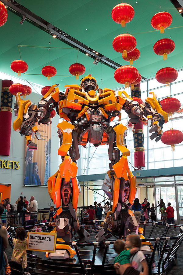 """In the Museum lobby, a huge Transformer, part of the """"Transformers: More Than Meets the Eye"""" exhibit from March 7th-July 26th, 2015, greets visitors to the world's largest children's museum, The Children's Museum in Indianapolis, Indiana, USA"""