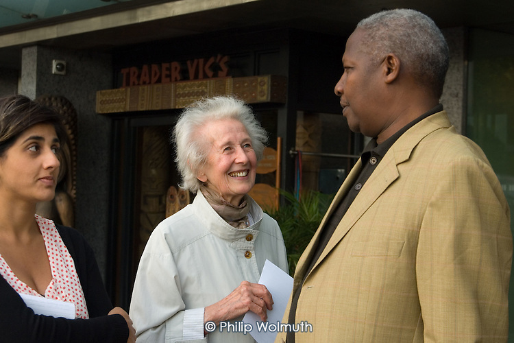 81 year-old Lotte Henley, a member of West London Citizens, talks to a guest at the Hilton Hotel, Park Lane, during an unannounced visit to promote the organisation's Living Wage Campaign.