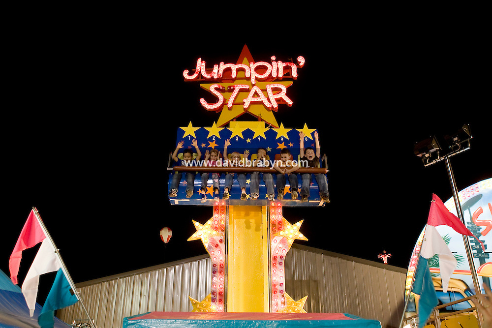 Children enjoy the Jumpin' Star carnival ride at the North Carolina State Fair in Raleigh, NC, United States, 16 October 2008.