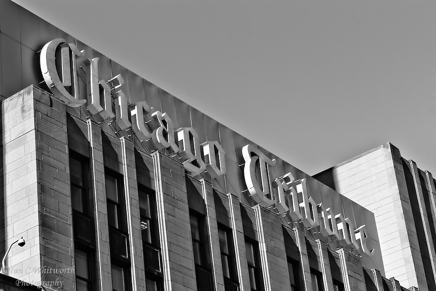 A blak and white view of the Chicago Tribune sign on their building