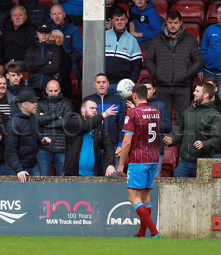 7th October 2017, Glanford Park, Scunthorpe, England; EFL League One football, Scunthorpe versus Wigan; Rory McArdle of Scunthorpe United is tormented by the Wigan Athletic fans as they refuse to give the ball back late in the 1-2 for Wigan
