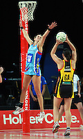 28.06.2010 Magic's Jodi Brown and Steels Leana de Bruin in action during the ANZ Champs Semi Final netball match between the Magic and Steel played at Vector Arena in Auckland. ©MBPHOTO/Michael Bradley