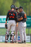 Delmarva Shorebirds manager Luis Pujols (55) has a chat on the mound with catcher Wynston Sawyer (30) and starting pitcher Juan Guzman (15) during the game against the Kannapolis Intimidators at CMC-Northeast Stadium on April 17, 2013 in Kannapolis, North Carolina.  The Shorebirds defeated the Intimidators 9-4.  (Brian Westerholt/Four Seam Images)