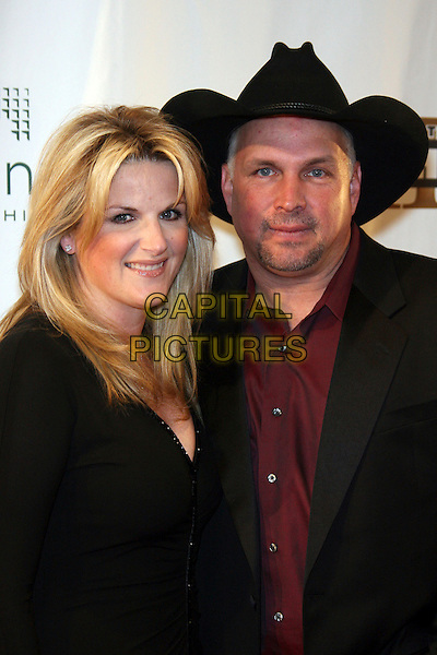 TRISHA YEARWOOD & GARTH BROOKS.Celebrity Fight Night XII held at JW Marriot Desert Ridge Resort & Spa, Phoenix, Arizona, USA..March 18th, 2006.Photo: Zach Lipp/AdMedia/Capital Pictures.Ref: ZL/ADM.headshot portrait married husband wife stetson.www.capitalpictures.com.sales@capitalpictures.com.© Capital Pictures.