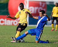 Jason Wright (10) of Jamaica is tackled by Alvaro Tuna (4) of Guatemala during the group stage of the CONCACAF Men's Under 17 Championship at Catherine Hall Stadium in Montego Bay, Jamaica. Jamaica defeated Guatemala, 1-0.