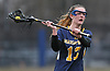Erin Tierney #13 of Massapequa makes a pass during a Nassau County varsity girls lacrosse game against host Manhasset High School on Tuesday, March 27, 2018. Manhasset won by a score of 11-8.