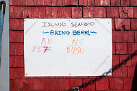"A sign displays the current prices being paid for AB and NS lobster at Island Seafood's ""bait shop"" where fishermen bring lobsters to sell to the dealer in on Badger's Island in Kittery, Maine, USA, on Wed., Jan. 31, 2018. ""AB"" lobster are lobsters that are considered good for shipping to customers alive. ""NS"" means ""new shell"" lobsters that aren't strong enough to be shipped alive; they are instead sent to a processing plant to package as frozen or cooked lobster."
