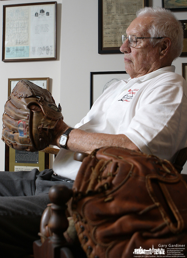 Hall of Fame baseball pitcher Bob Feller sits in his basement in front of baseball memorabilia Wednesday, June 27, 2007, in Gates Mills, Ohio.