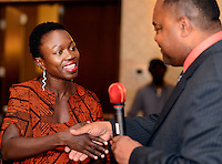 G1FUNN12C<br /> Aden Bayou (left) is handed an award from Rohan Hopkins during the FunTimes Magazine 5th Annual Gala Saturday October 10, 2015 at the Renaissance Hotel in Philadelphia, Pennsylvania. The event featured a dinner dance as well as the recipients of three awards. (William Thomas Cain/For The Inquirer)
