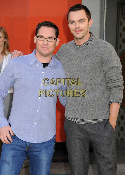 Bryan Singer, Nicholas Hoult.'Jack The Giant Slayer' footprint unveiling at the TCL Chinese Theatre, Hollywood, California, USA, 28th February 2013.half length grey jumper pullover.CAP/ADM/BP.©Byron Purvis/AdMedia/Capital Pictures.