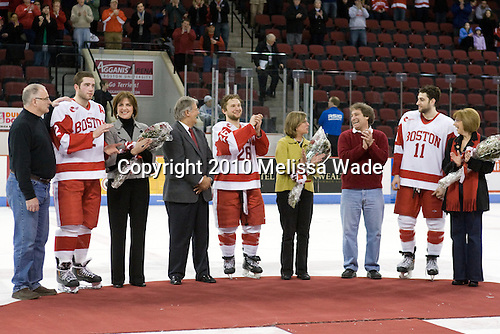Shawn Gryba, Eric Gryba (BU - 2), Catherine Gryba, George Popko, Luke Popko (BU - 26), Sandra Popko, Mark Cohen, Zach Cohen (BU - 11), Sue Cohen - The Boston University Terriers defeated the Northeastern University Huskies 5-4 on Friday, March 5, 2010, in their senior night game at Agganis Arena in Boston, Massachusetts.
