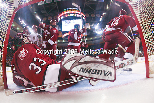 Kyle Richter (Harvard 33) makes a save. The Boston College Eagles defeated the Harvard University Crimson 6-5 in overtime on Monday, February 11, 2008, to win the 2008 Beanpot at the TD Banknorth Garden in Boston, Massachusetts.