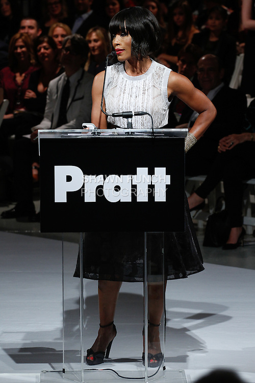 """Actress Angela Bassett honors designers Byron Lars, for his 2014 Pratt Fashion Visionary Award, at the 115th Annual Pratt Institute 2014 """"Under Construction"""" collection Student Runway Show;  at Center548 in NYC, on May 1, 2014."""