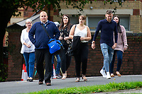COPY BY TOM BEDFORD<br /> Pictured: Craig Dewar (2nd left) and Zoe Dewar (centre) arrive at Newport Crown Court, Wales, UK. Monday 19 August 2019<br /> Re: A jealous husband who kidnapped a love rival in a 'carjacking' when he discovered he had a passionate affair with his social worker wife, is due to be sentenced by Newport Crown Court, Wales, UK.<br /> Craig Dewar was accused of abducting John Hawkins in Blaenavon after finding out Zoe Dewar had cheated on him behind his back with a work colleague.<br /> The complainant met while working together as community support workers for Blaenau Gwent Social Services.<br /> Craig Dewar, 34, followed Mr Hawkins, muscled his way into his van after overtaking him and slamming on the breaks, forcing him to stop sharply and blocking his path.