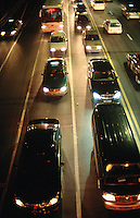 China. Province of Zhejiang. Hangzhou. Traffic on the road at night time. Cars wait on line for the green light. © 2004 Didier Ruef