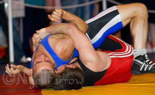 22 MAY 2010 - BIRMINGHAM, GBR -  Damion Arzu (blue) v Cristian Lasar (red) - 2010 English Senior Wrestling Championships .(PHOTO (C) NIGEL FARROW)
