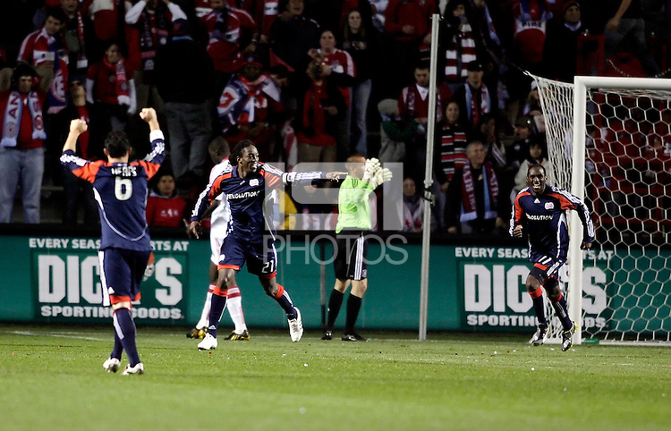 New England midfielder Shalrie Joseph (21) celebrates after scoring the game tying goal.  The Chicago Fire tied the New England Revolution 1-1 at Toyota Park in Bridgeview, IL on May 9, 2009.