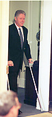 United States President Bill Clinton enters the Roosevelt Room for an announcement on Health Care Fraud in the Roosevelt room of the White House in Washington, DC on March 25, 1997.<br /> Credit: Ron Sachs / CNP