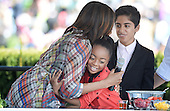 Comedian Skai Jackson and Karan Brar (R) from the comedy series Jessie make a healthy fruits salad with First Lady Michelle Obama during the annual White House Easter Egg Roll on the South Lawn of the White House April 21, 2014 in Washington, DC. President Barack Obama and first lady Michelle Obama hosted thousands of people during the annual celebration of Easter. <br /> Credit: Olivier Douliery / Pool via CNP
