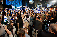 September 4, 2012 - Montreal (Qc) CANADA -  <br /> <br /> Parti Quebecois (PQ) fans wave flags and cheers as they listen to the results early in the evening of the election night<br /> <br /> Parti Quebecois (PQ) leader Pauline Marois  won the provincial election and become the first woman elected as Quebec Premier.<br /> <br /> Her speech was interrupted by her bodyguard grabbing her offstage when a man entered the building shooting 2 person (one died so far) and throwing a Molotov cocktail outside.