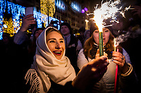 01/01/2020, Moscow, Russia.<br /> People light fireworks in the street as revellers celebrate Russian New Year in central Moscow.
