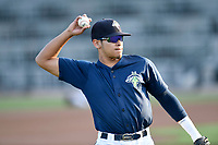Shortstop Edgardo Fermin (10) of the Columbia Fireflies warms up before a game against the Charleston RiverDogs on Monday, August 27, 2018, at Spirit Communications Park in Columbia, South Carolina. Charleston won, 4-0. (Tom Priddy/Four Seam Images)