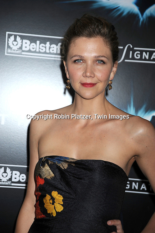 """Maggie Gyllenhaal in Dries Van Noten dress..posing at The World Premiere of """"The Dark Knight""""  on July 14, 2008 at The AMC Loews Lincoln Square in New York City.  The premiere was sponsered by VISA and Belstaff.....Robin Platzer, Twin Images"""