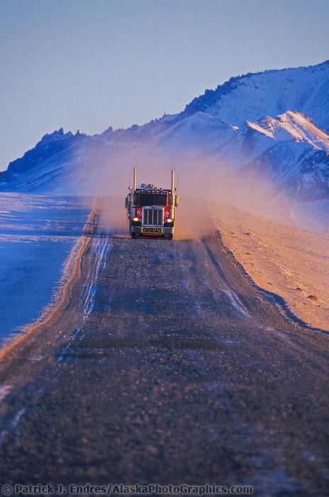 Semi truck hauls supplies to Prudhoe Bay Oil fields, James Dalton Highway, Brooks Range, Arctic, Alaska