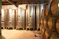 Barrels of wine aging in the cellar stainless steel fermentation tanks Chateau Vannieres (Vannières) La Cadiere (Cadière) d'Azur Bandol Var Cote d'Azur France