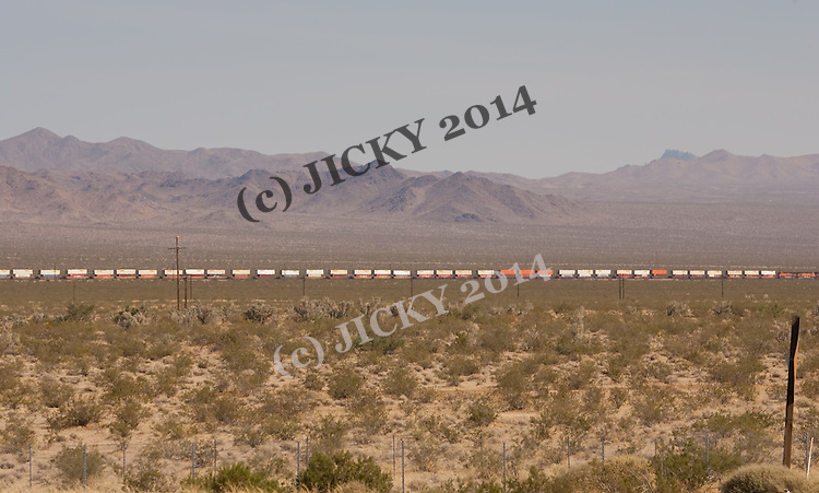 Freight train against the Sacramento Mountains off I-40.