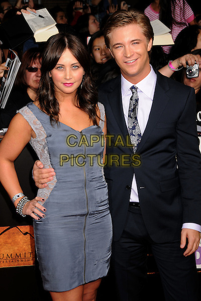 "MARISSA LEFTON & MICHAEL WELCH.""Twilight: New Moon"" Los Angeles Premiere held at Mann's Village Theatre, Westwood, California, USA..November 16th, 2009.half length blue grey gray dress hand on hip black suit jacket  hand on hip.CAP/ADM/BP.©Byron Purvis/AdMedia/Capital Pictures."