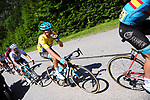 The peloton including Yellow Jersey Jakob Fuglsang (DEN) Astana Pro Team in action during Stage 8 of the Criterium du Dauphine 2019, running 113.5km from Cluses to Champery, Switzerland. 16th June 2019.<br /> Picture: Colin Flockton | Cyclefile<br /> All photos usage must carry mandatory copyright credit (© Cyclefile | Colin Flockton)