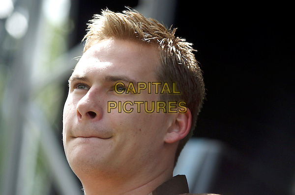 LEE RYAN.Performs live in concert at 96.4 BRMB's Party In The Park, Cannon Hill Park, Birmingham, .July 3rd 2005..portrait headshot funny mouth lips.Ref: JEZ.www.capitalpictures.com.sales@capitalpictures.com.©Jez Self/Capital Pictures