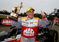Mar 16, 2014; Gainesville, FL, USA; NHRA top fuel driver Doug Kalitta celebrates after winning the Gatornationals at Gainesville Raceway Mandatory Credit: Mark J. Rebilas-USA TODAY Sports
