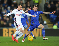 Bolton Wanderers' Adam Le Fondre vies for possession with Cardiff City's Joe Ralls<br /> <br /> Photographer Kevin Barnes/CameraSport<br /> <br /> The EFL Sky Bet Championship - Cardiff City v Bolton Wanderers - Tuesday 13th February 2018 - Cardiff City Stadium - Cardiff<br /> <br /> World Copyright &copy; 2018 CameraSport. All rights reserved. 43 Linden Ave. Countesthorpe. Leicester. England. LE8 5PG - Tel: +44 (0) 116 277 4147 - admin@camerasport.com - www.camerasport.com