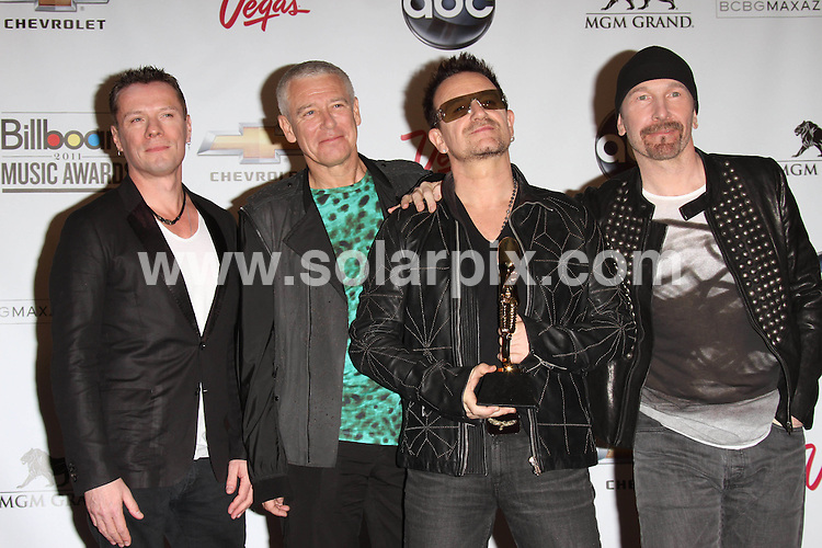 **ALL ROUND PICTURES FROM SOLARPIX.COM**                                             **SYNDICATION RIGHTS FOR UK, AUSTRALIA, DENMARK, PORTUGAL, S. AFRICA, SPAIN & DUBAI (U.A.E) & ASIA (EXCLUDING JAPAN) ONLY**                                                                                  Caption: Press Room at the 2011 Billboard Music Awards, held at the MGM Grand Garden Arena in Las Vegas, USA. 22 May 2011                                                                              This pic: U2                                                                     JOB REF: 13407 PHZ Evans      DATE: 22_05_2011                                                           **MUST CREDIT SOLARPIX.COM OR DOUBLE FEE WILL BE CHARGED**                                                                      **MUST AGREE FEE BEFORE ONLINE USAGE**                               **CALL US ON: +34 952 811 768 or LOW RATE FROM UK 0844 617 7637**